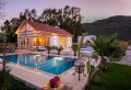 Luxury 2 bedroom villa in Kayakoy with secluded pool and garden.